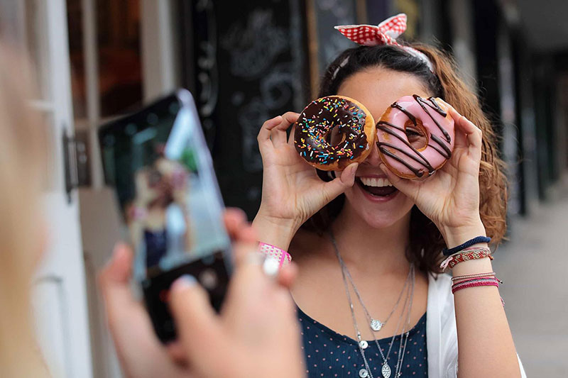 Girl holding donuts
